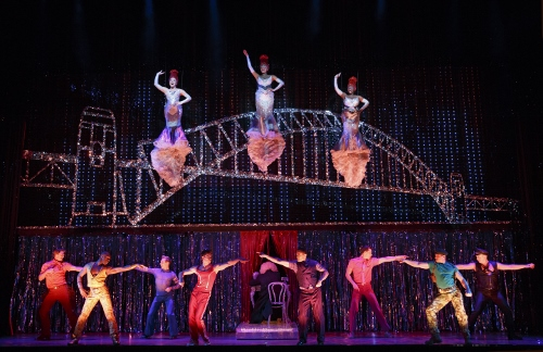Center left to right (flying): Emily Afton, Brit West and Bre Jackson and Company in the number 'It's Raining Men'
