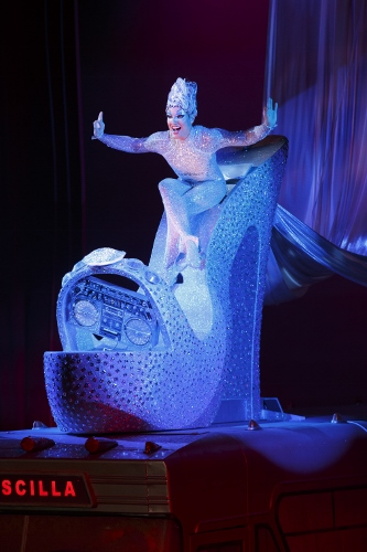 Bryan West as Felicia atop 'Priscilla' (bus) in the number 'Sempre Libera'