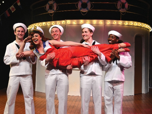 Erma (Sarah Joy Ledtke) sings 'Buddie Beware' to her potential sailor suitors (from left) Blake Spellacy, Ian Frazier, Stephen Barnowski and Sam McKanney in Beef & Boards Dinner Theatre's current production of Anything Goes.