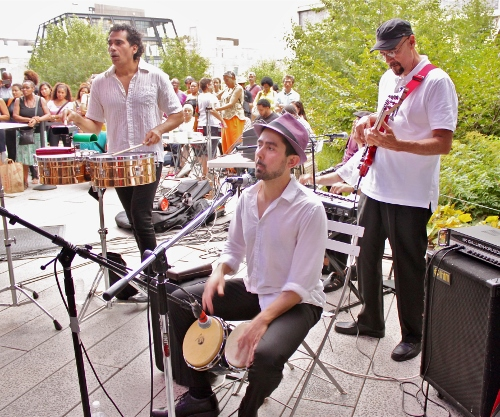from left to right: Nestor Villar, timbales; David Freyre, bongos; Enrique Breton, bass.