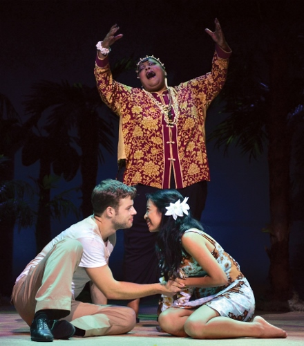 Bloody Mary (Cynthia Thomas) sings 'Happy Talk' to Lt. Joseph Cable (Mickey Rafalski) and Liat (Arianne Villareal) in Beef & Boards Dinner Theatre's production of South Pacific. The Rodgers & Hammerstein musical is now on stage through Oct. 4. Tickets include Chef Odell Ward's dinner buffet.