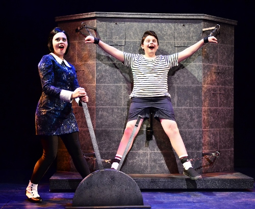 """Wednesday Addams (Samantha Russell), left, tortures her younger brother Pugsley (Simon Barnes) as she admits being """"Pulled"""" in a new direction with her love for Lucas in Beef & Boards Dinner Theatre's production of the musical comedy The Addams Family, now on stage through Nov. 22."""