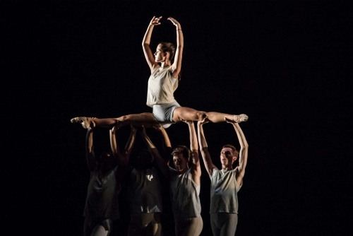 "Anna Barnes aloft with other IU Ballet Theater dancers in Twyla Tharp's ""Surfer at the River Styx."""