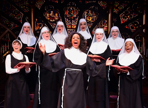 Lounge singer Deloris Van Cartier (Zuri Washington), center, teaches the nuns of Queen of Angels Church a new way to sing the Lord's praises in Beef & Boards Dinner Theatre's production of Sister Act, now on stage through March 25. Broadway's divine musical comedy is based on the film of the same name that starred Whoopi Goldberg in the role of Deloris.