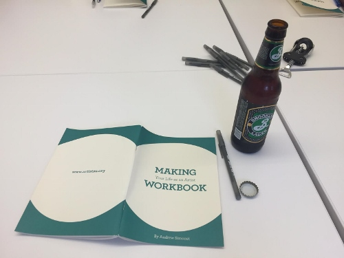 Andrew Simonet's 'Making Your Life as an Artist' Workbook, pens, a bottle opener, and Brooklyn Breweries lager: supplies distributed to attendees at the start of the second evening of DEEP.