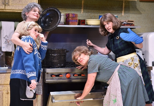 Vivan Snustad (Licia Watson), at left in back, savors the pungent aroma as she lifts the lid from a pot of lutefisk, a traditional Lutheran preparation of cod, in Beef & Boards Dinner Theatre's current production of 'Church Basement Ladies.' Unable to share her enthusiasm for the dish are (from left) Signe Engelson (Lindsay Sutton), Mavis Gilmerson (Karen Pappas) and Karin Engelson (Dawn Trautman). The hilarious musical comedy is live on stage through Aug. 21.