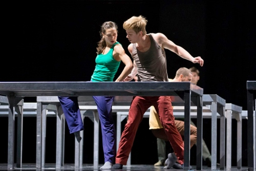 Hubbard Street Dancers Jacqueline Burnett and David Schultz in William Forsythe's One Flat Thing, reproduced, with, upstage, Jesse Bechard and Michael Gross.