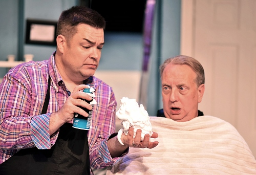 Nick O'Brien (Jeff Stockberger), right, watches as Tony Whitcomb (Daniel Klingler) fills his hand with shaving cream as he prepares to give Nick a shave in Beef & Boards Dinner Theatre's 2017 Season opener, Shear Madness. Now on stage through Jan. 29, this madcap murder mystery takes place in a not-so-typical Indianapolis hair salon – and the audience decides how it ends!