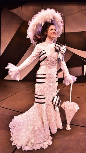 Eliza Doolittle (Kimberly Doreen Burns) makes her first appearance among high society to test her ability to convince them that she is a proper lady in Beef & Boards Dinner Theatre's production of My Fair Lady, now on stage through May 14. The Tony Award winning musical is returning to the Beef & Boards stage after a 20-year hiatus.