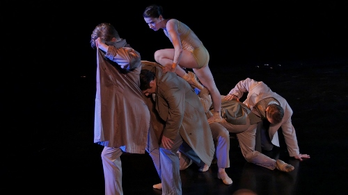 "From 2016's 'The Benefit': BalletMet's Caitlin Valentine-Ellis atop dancers in Atilla Bongar's ""Forced March: Second Eclogue."""