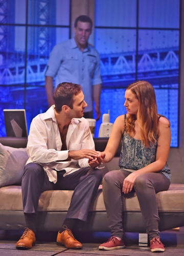 Life Turns on a Dime: Sam (Eddie Egan), at back, is horrified that his former friend Carl (Patrick Michael Joyce), seated at left, not only had him killed but is trying to seduce his girlfriend Molly (Andrea Laxton) in Ghost, The Musical, now on stage at Beef & Boards Dinner Theatre. Based on the hit 1990 film, this Broadway adaptation is making its debut at Beef & Boards, and is on stage through Nov. 18. Tickets include Chef Odell Ward's dinner buffet. For reservations, contact the box office at 317.872.9664. For more information and show schedule, visit beefandboards.com. This show is rated PG-13.