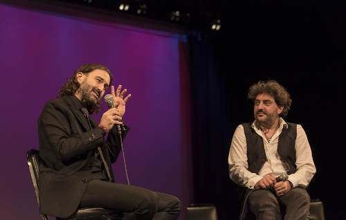 A pre-concert talk with the producer Javier Limón on the left and harmonic player Antonio Serrano on the right.