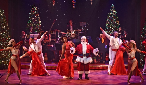 Santa and featured singer Renée Jackson (center) take the stage in the 25th Annual A Beef & Boards Christmas, now on stage at Beef & Boards Dinner Theatre.
