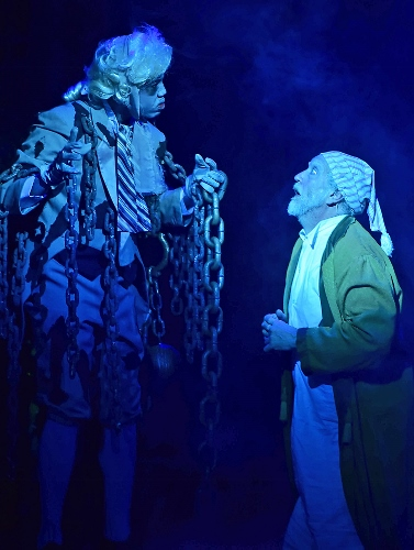 The ghost of his business partner Jacob Marley (Joshua L.K. Patterson), left, visits Ebenezer Scrooge (Jeff Stockberger) on the night of Christmas Eve in Beef & Boards Dinner Theatre's one-hour production of 'A Christmas Carol'.