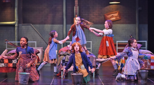 "Hard Knock Life: The orphans sing about their ""Hard Knock Life"" in Beef & Boards Dinner Theatre's production of Annie, now on stage through July 15."