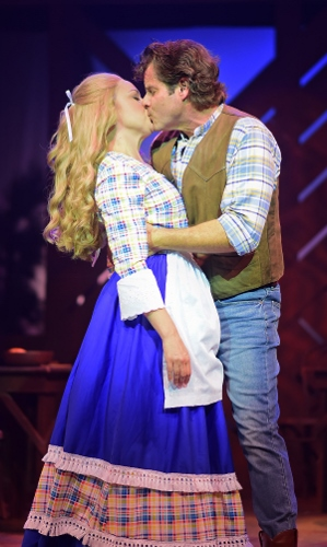 "After proposing to Milly (Krista Severeid), Adam Pontipee (Tony Lawson) kisses her in Seven Brides for Seven Brothers, now on stage at Beef & Boards Dinner Theatre through Oct. 7. The real-life husband and wife star in this rip-roaring stage version of the classic MGM film that bursts with energetic dance numbers and famous songs including ""Wonderful, Wonderful Day,"" ""Bless Your Beautiful Hide,"" and ""Goin' Courting."""
