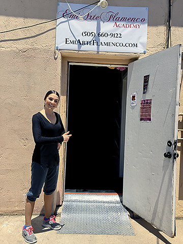 La Emi welcomes all at the doorway to her studio.