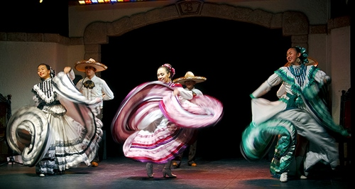 Guest artists at a performance include a Mexican folkloric troupe.