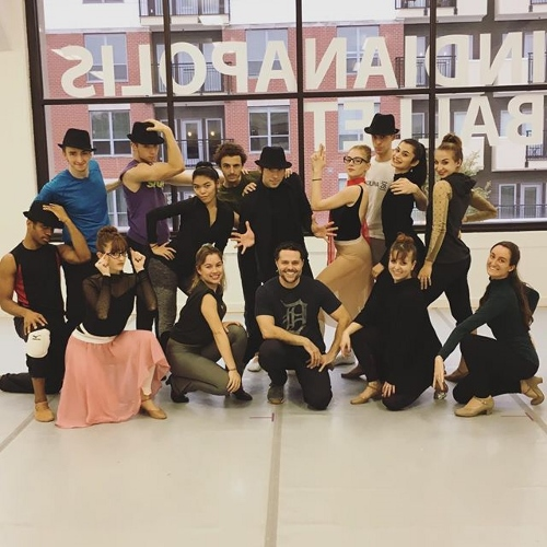 Choreographer Joshua Bergasse (center) poses with Indianapolis Ballet dancers after a rehearsal of his work 'Aspects of Andy.'