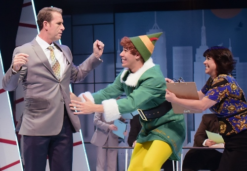 Overwhelmed with excitement at their first meeting, Buddy (Dan Bob Higgins), center, rushes to hug his father Walter Hobbs (Mark Epperson) but is pulled back by Deb (Lanene Charters) in Beef & Boards Dinner Theatre's production of Elf, The Musical, now on stage through Dec. 31.