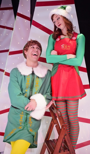 "After being taken to the ""North Pole"" at Macy's, Buddy (Dan Bob Higgins), left, sees Jovie (Emily Grace Tucker), right, and is overcome by her beauty in Beef & Boards Dinner Theatre's production of Elf, The Musical, now on stage through Dec. 31."