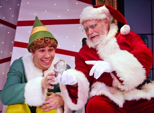 After confirming to Buddy (Dan Bob Higgins), left, that he's human, Santa gives him a snow globe to show him what the Empire State Building, where his father works, looks like in Beef & Boards Dinner Theatre's production of Elf, The Musical, now on stage through Dec. 31.