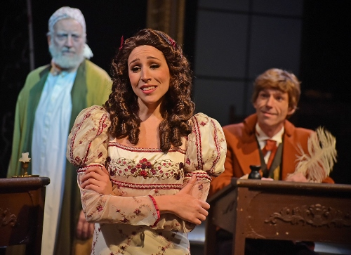 Belle (Jenny Reber), center, realizes her fiancé young Ebenezer Scrooge (Michael Shelton), right, has changed and decides to break off their engagement as the present-day Scrooge (Jeff Stockberger), left, watches in dismay in Beef & Boards Dinner Theatre's production of A Christmas Carol, on stage select dates through Dec. 21.
