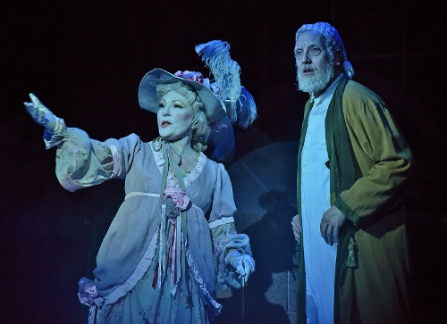 The Ghost of Christmas Past (Vickie Cornelius Phipps), left, visits Ebenezer Scrooge (Jeff Stockberger) in the middle of the night on Christmas in Beef & Boards Dinner Theatre's production of A Christmas Carol, on stage select dates through Dec. 21.