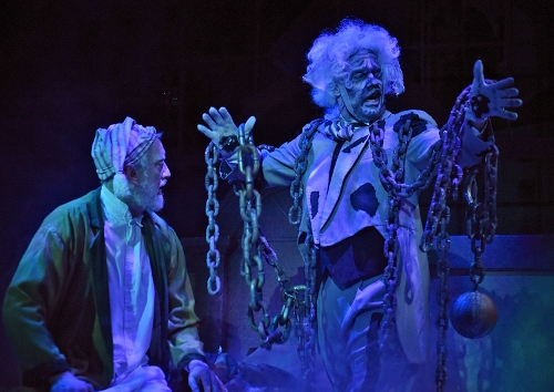 The ghost of Jacob Marley (Lance Gray), right, visits his former partner Ebenezer Scrooge (Jeff Stockberger) to warn him that three spirits will visit him through the night in Beef & Boards Dinner Theatre's production of A Christmas Carol, on stage select dates through Dec. 21.