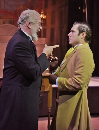 Bob Cratchit (Logan Moore), right, is stunned at the sudden transformation of his employer, Ebenezer Scrooge (Jeff Stockberger), left, in Beef & Boards Dinner Theatre's production of A Christmas Carol, on stage select dates through Dec. 21.