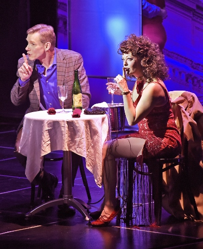 """Listening their new love song, Vernon (David Schmittou) and Sonia (Sarah Hund) urge everyone to """"Shh, shh, shh"""" in Beef & Boards Dinner Theatre's production of They're Playing Our Song. On stage through Feb. 3, the Neil Simon and Marvin Hamlisch romantic musical comedy opens Beef & Boards' 46th Season."""