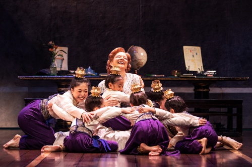 Angela Baumgardner as Anna Leonowens and the Royal Children in Rodgers & Hammerstein's THE KING AND I.