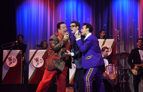 "The Big Bopper (Chuck Caruso), Buddy Holly (Kyle Jurassic), and Ritchie Valens (Edward LaCardo) sing together during the concert in Clear Lake, Iowa, in Beef & Boards Dinner Theatre's production of Buddy: The Buddy Holly Story, now on stage. This high-energy musical features Buddy's greatest hits including ""Oh Boy,"" ""Peggy Sue,"" and ""Everyday."""