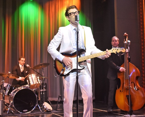 "Buddy Holly (Kyle Jurassic) performs with the Crickets, Jerry Allison (Josh McLemore), on drums, and Joe Maudlin (James Daley), on bass, in Beef & Boards Dinner Theatre's production of Buddy: The Buddy Holly Story, now on stage. This high-energy musical features Buddy's greatest hits including ""Oh Boy,"" ""Peggy Sue,"" and ""Everyday."""
