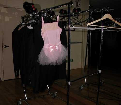 SparkleTutu, the successor to <a href='http://www.exploredance.com/list.htm?s=topic&amp;sid=47'>PinkTop</a>, is a pink leotard with tutu liberally covered in rhinestones. SparkleTutu brightens up any room, even if most people wouldn't actually wear a tutu at a ballroom party (my 4 and a half year old neice might, though). SparkleTutu, and thousands of other dance clothing and shoes, are available at <a href='http://www.onstagedancewear.com'>OnStageDancewear.com</a>, a dance retailer providing friendly service whether you buy in their store or on the web. Watch ExploreDance.com for future appearances by SparkleTutu in all of the unexpected places we can think of.