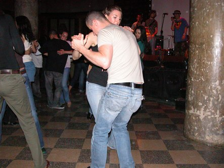 Dancers in close embrace
