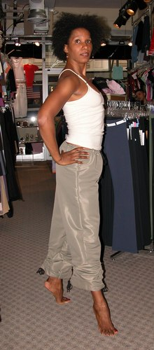 Tan top by Marika. Dark khaki ankle-tie pants by Capezio. Modeled by Kendra Jackson. Available at <a href='http://www.onstagedancewear.com'>OnStageDancewear.com</a>.