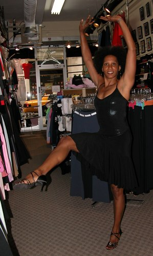 Black top by Baltogs. Flared black skirt by Body Wrappers. Black 'Sophia' shoes by Freed of London. Modeled by Kendra Jackson. Available at <a href='http://www.onstagedancewear.com'>OnStageDancewear.com</a>.
