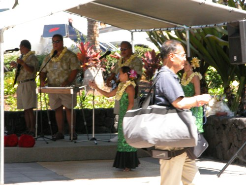 Traveler with Carry-On Bag at Keahole-Kona International Airport