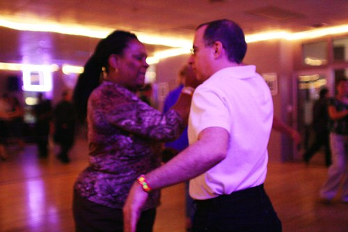 Swing 'n Salsa Party - West Coast Swing Room Camera: ISO 3200, 1/125, 1.4, Brightness adjusted using Curves in Photoshop
