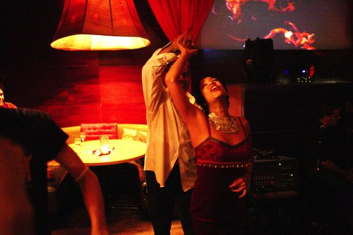 Talia dances at Taj Camera: ISO 6400, 1/125, 1.4, Brightness adjusted using Curves in Photoshop