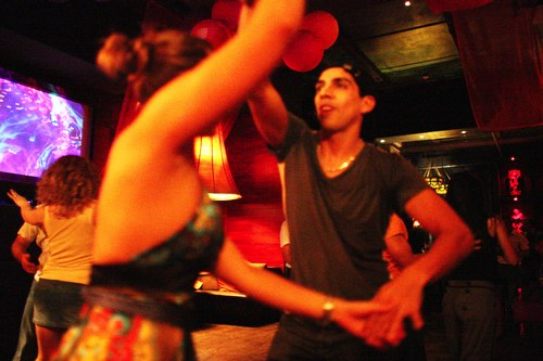 Dancing at Taj Camera: ISO 6400, 1/80, 1.4, Brightness adjusted using Curves in Photoshop