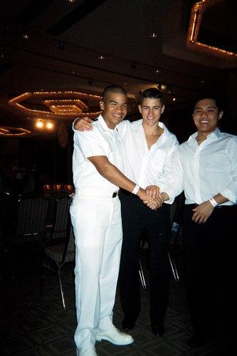 At the competition Uniformed Castillo congratulates his fellow midshipmen