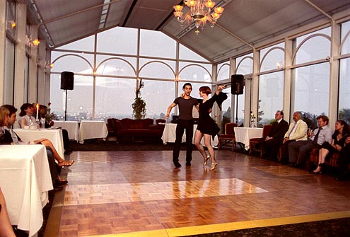Simone Assboeck and Ernesto Alonso Palma of Stepping Out Studios perform a Salsa