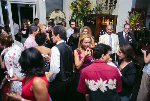 The guests partake of the food (passed around on silver trays no less) and the premium open bar