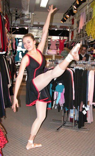 Cecilia is wearing a Black and Red Dress from Star Styled, $79.99. Available at <a href='http://www.onstagedancewear.com'>OnStageDancewear.com</a>.