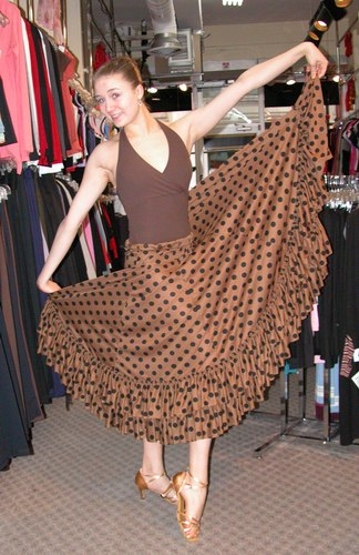 Cecilia is wearing a Halter Leotard from the Premiere Collection by Body Wrappers, Style P802, $48.99; Light Brown Flamenco Skirt, $69.99; and Gold 'Karen' shoes from Freed of London, $119. Available at <a href='http://www.onstagedancewear.com'>OnStageDancewear.com</a>.