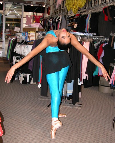 Kimberly is wearing a Electric Blue Unitard, Style 7931-NL, $59.99; and a Black Danskin New York City Ballet Collection Short Wrap Skirt, Style 934, $26.99. Available at <a href='http://www.onstagedancewear.com'>OnStageDancewear.com</a>.