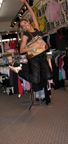 Kimberly is wearing Black Pants by Body Wrappers, Style 701, $24.99; and a New York City Ballet Logo Tee Shirt, Style 6239, $28.99. She is carrying a Galleria Enterprises Degas Bag, Style 70204, $26.99. Available at <a href='http://www.onstagedancewear.com'>OnStageDancewear.com</a>.