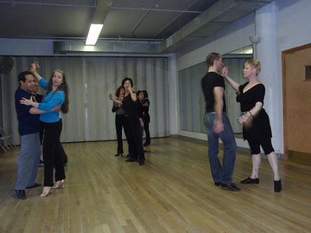 Jules Helm demonstrating a routine in Advanced International Cha Cha class.